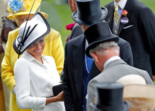 Meghan Markle stands with Prince Harry and Prince Charles at Day 1 of the Royal Ascot on June 19, 2018