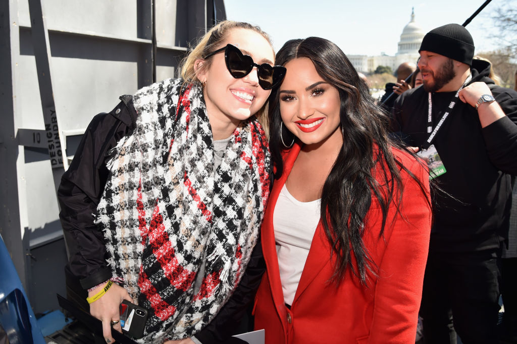 Miley Cyrus and Demi Lovato at an event in March 2018