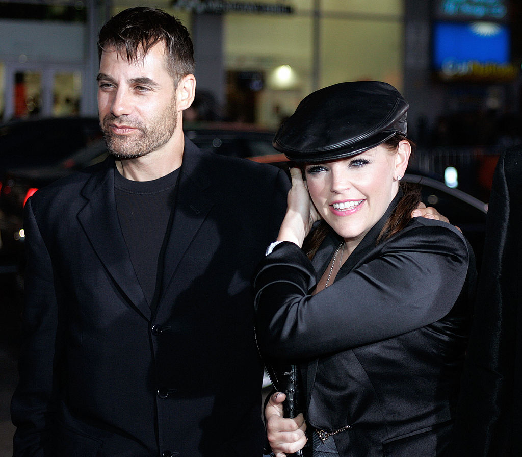 Dixie Chicks singer and actress Natalie Maines and her husband Adrian Pasdar pose for photographers
