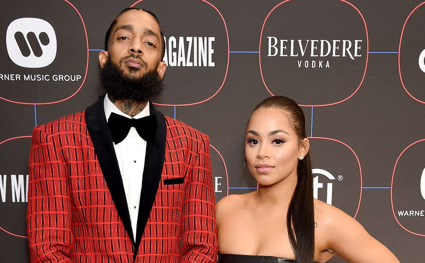 Nipsey Hussle and Lauren London on the red carpet at an event in February 2019