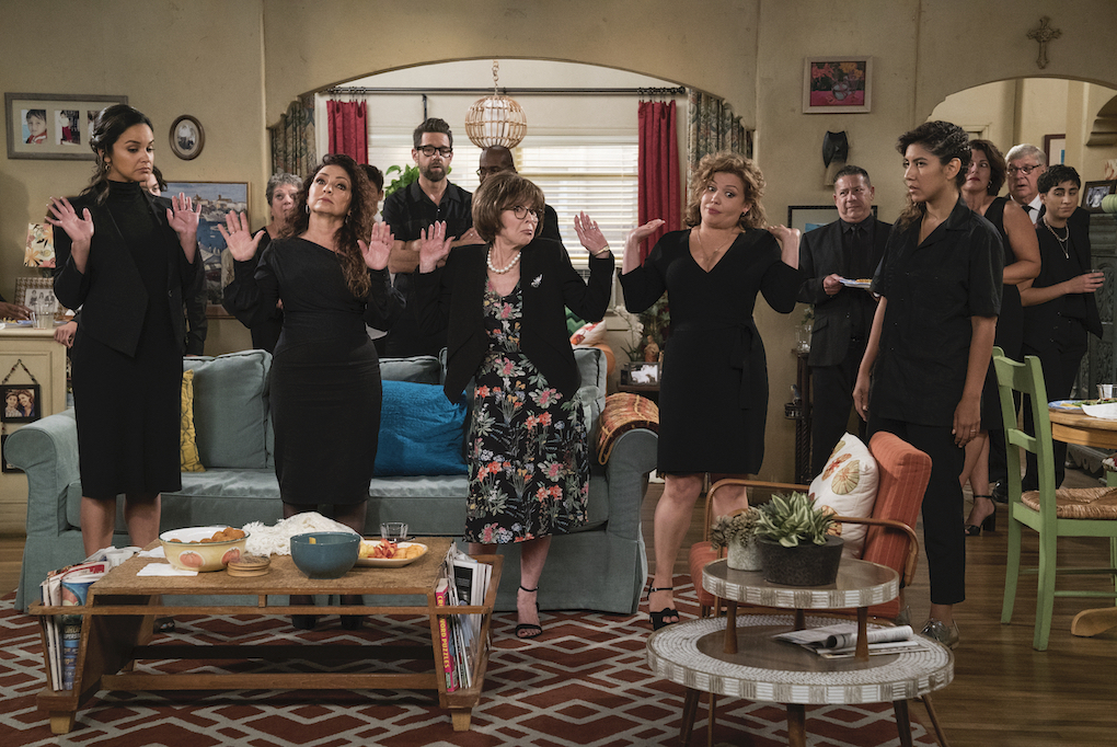 Penelope (Justina Machado), Lydia (Rita Moreno), and others at a funeral in Episode 7, Season 3, 'One Day at a Time.'