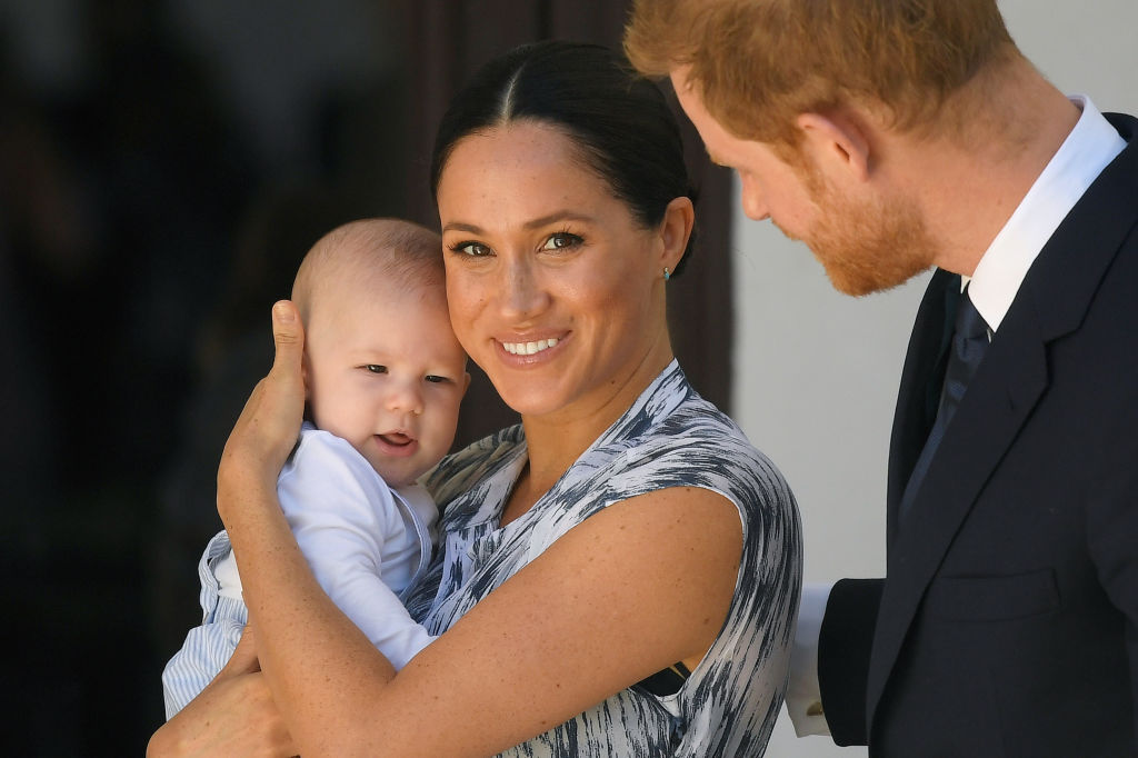 Prince Harry and Meghan Markle and their baby son Archie Mountbatten-Windsor at a meeting with Archbishop Desmond Tutu