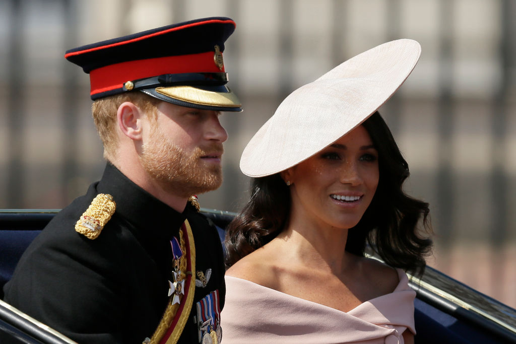 Prince Harry and Meghan Markle depart from Buckingham Palace during the Trooping the Colour ceremony