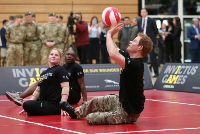 Prince Harry plays sitting volley ball on March 6, 2014, at the media launch for the 2014 Invictus Games