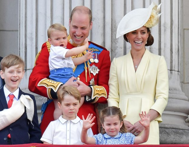 Prince William and Kate Middleton stand with their children Prince George, Princess Charlotte, and Prince Louis at Trooping the Colour on June 8, 2019