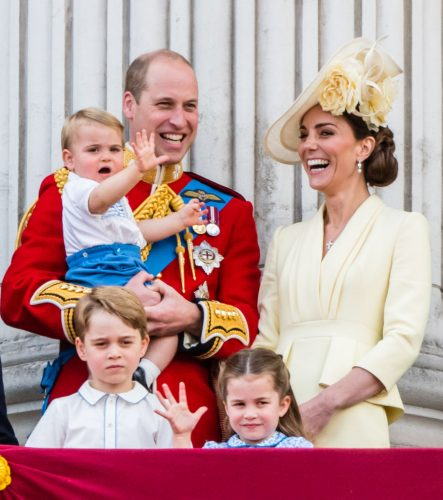 Prince William holds Prince Louis whiie standing next to Kate Middleton, Prince George, and Princess Charlotte at Trooping The Colour on June 8, 2019