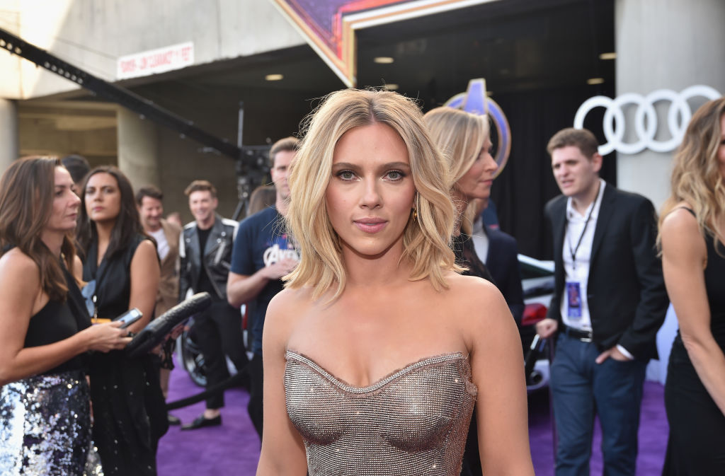 Scarlett Johansson smiling at the camera in a strapless dress