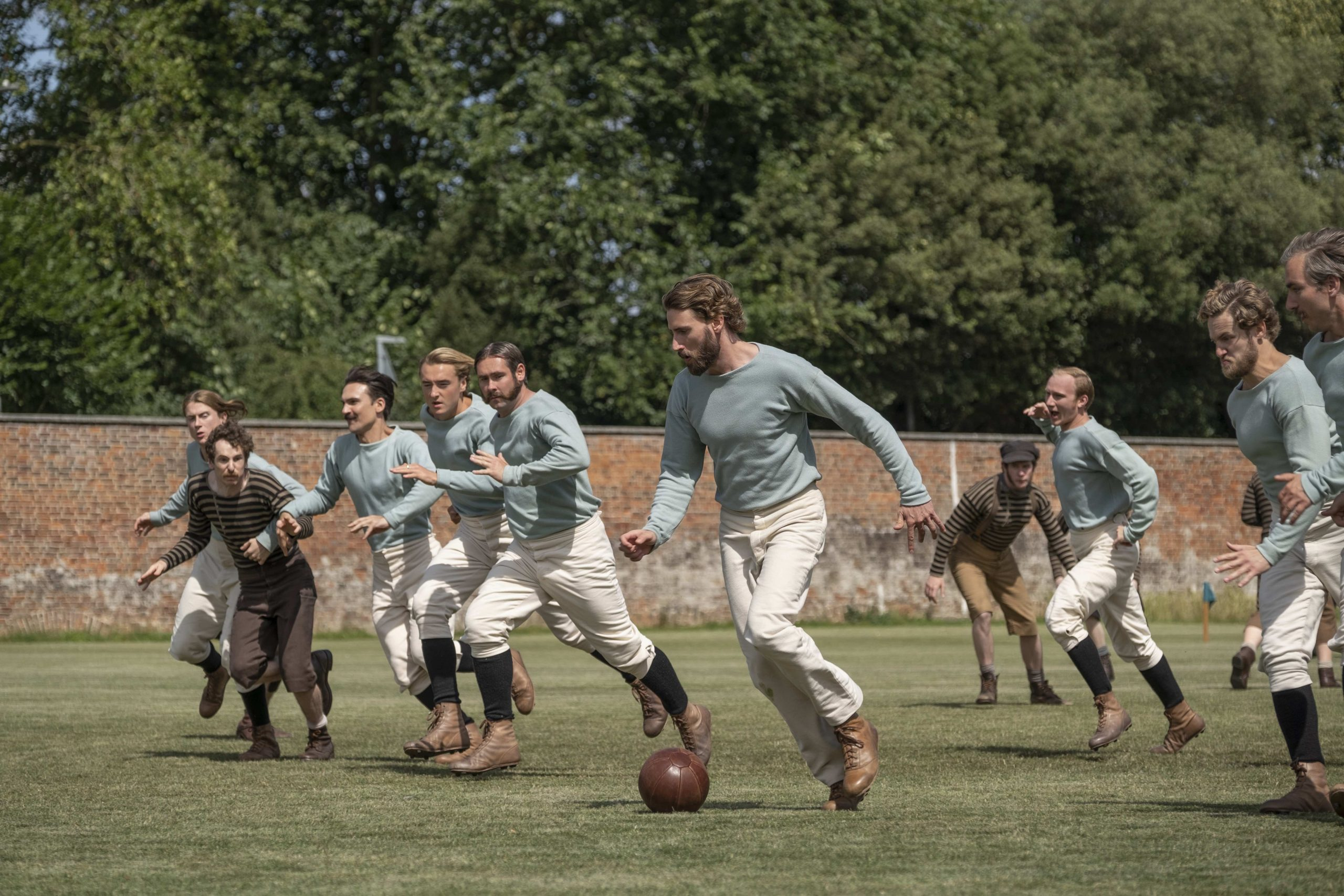 Men playing soccer in 'The English Game'
