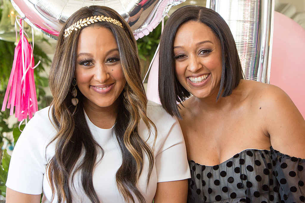 Tamera Mowry-Housley and Tia Mowry attend Tamera Mowry-Housley's in April 2015