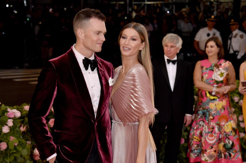 Tom Brady and Gisele Bündchen smiling in formal wear