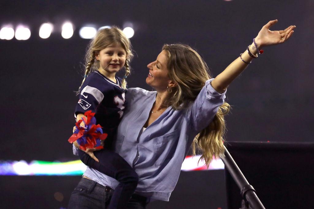 Vivian Brady and Giselle Bundchen   Ronald Martinez/Getty Images