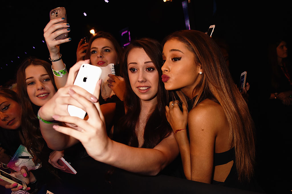 Ariana Grande takes a selfie with a fan as she attends the MTV EMA's 2014 on November 9, 2014 in Glasgow, Scotland.