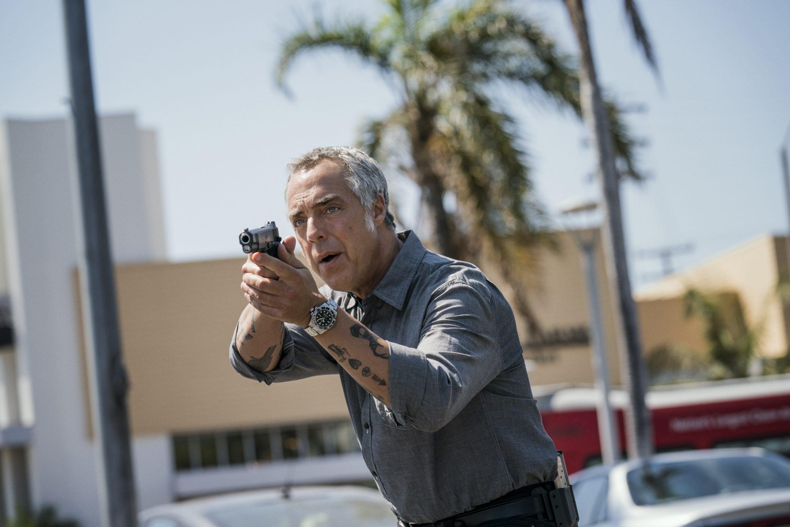 Titus Welliver pointing a gun in an episode of 'Bosch'