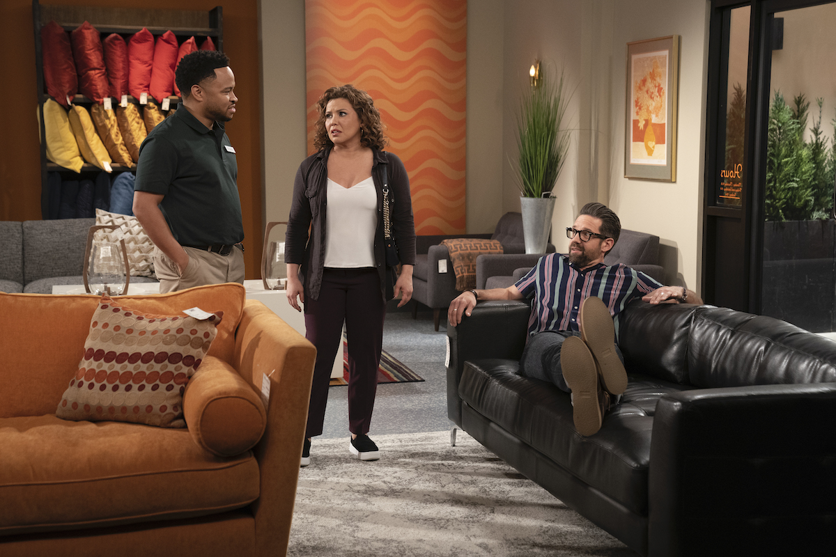 """Eugene Byrd as the salesman, Justina Machado as Penelope and Todd Grinnell as Schneider in """"Penny Pinching,"""" 'ONE DAY AT A TIME.'"""