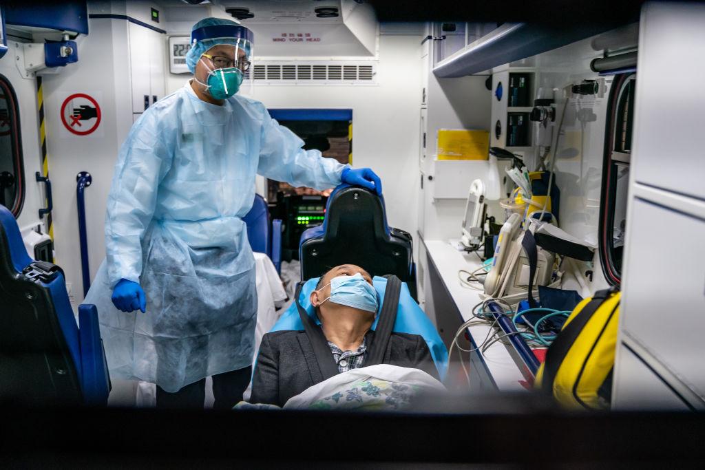 A Hong Kong coronavirus (COVID-19) patient is transferred by ambulance