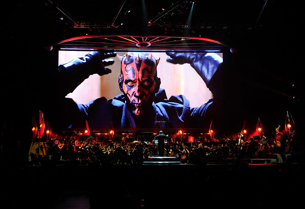 Ray Park as Darth Maul in 'Star Wars Episode I: The Phantom Menace,' shown on-screen while musicians perform during 'Star Wars: In Concert' at the Orleans Arena May 29, 2010 in Las Vegas, Nevada.