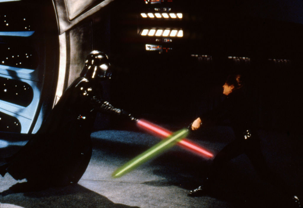 Darth Vader (David Prowse/James Earl Jones) and Luke Skywalker (Mark Hamill) fight in 'Star Wars: Episode VI - Return of the Jedi.'