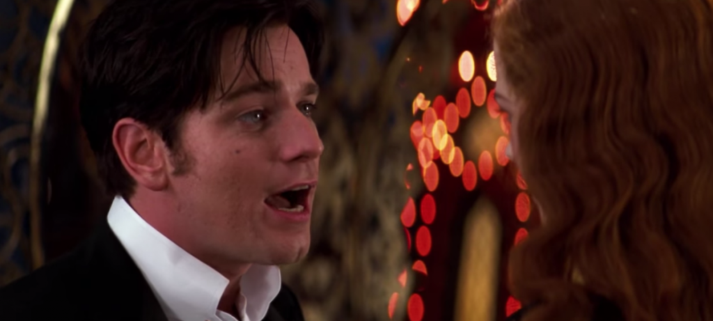 Christian (Ewan McGregor) singing to Satine (Nicole Kidman) for the first time in 'Moulin Rouge.'
