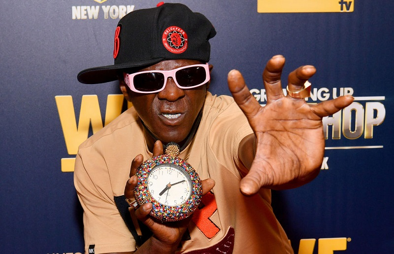 Flavor Flav reaching out with his hand