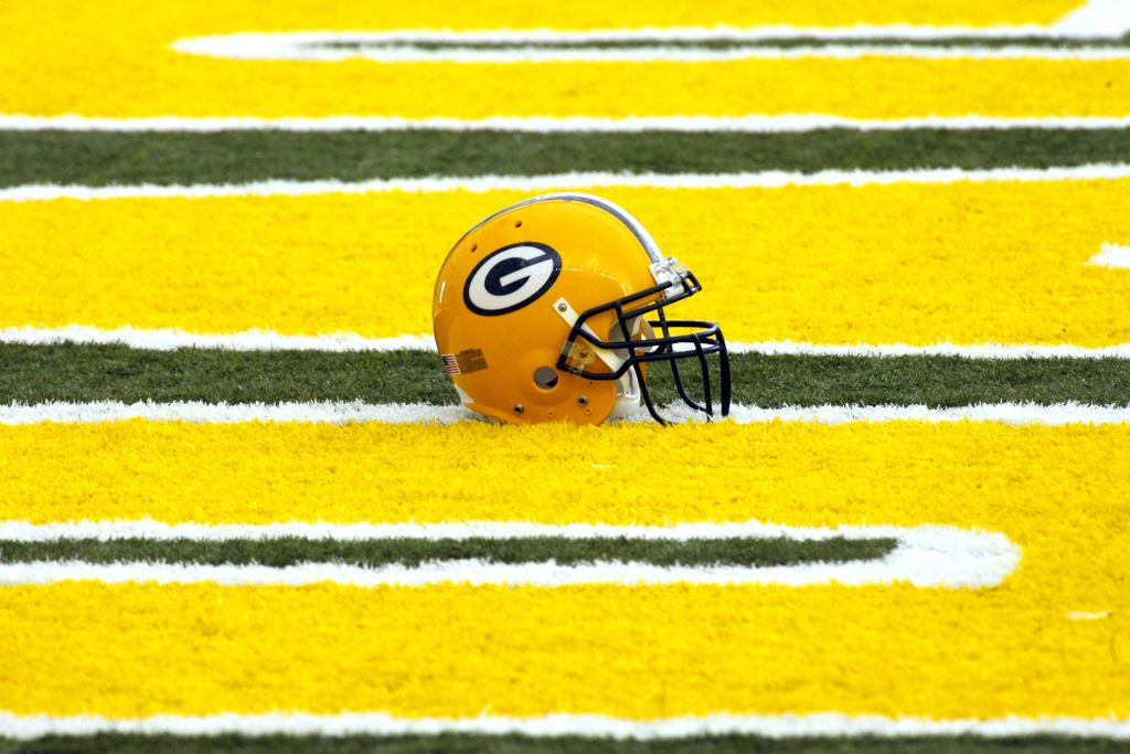 A Green Bay Packers helmet in an end zone