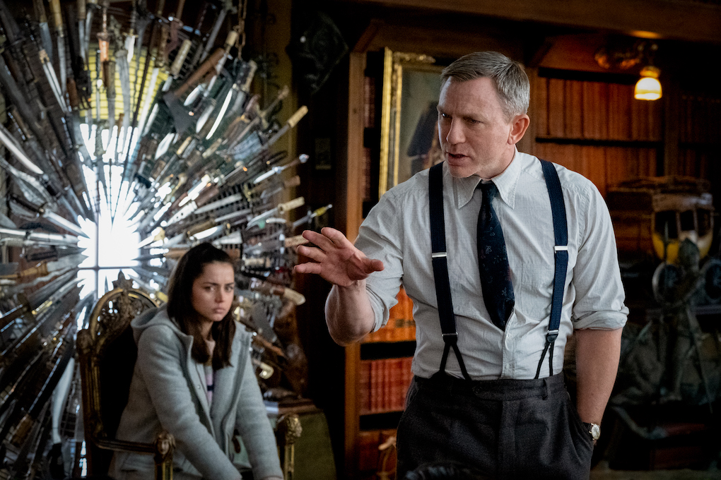 Ana de Armas as Marta Cabrera and Daniel Craig as Benoit Blanc in 'Knives Out.'