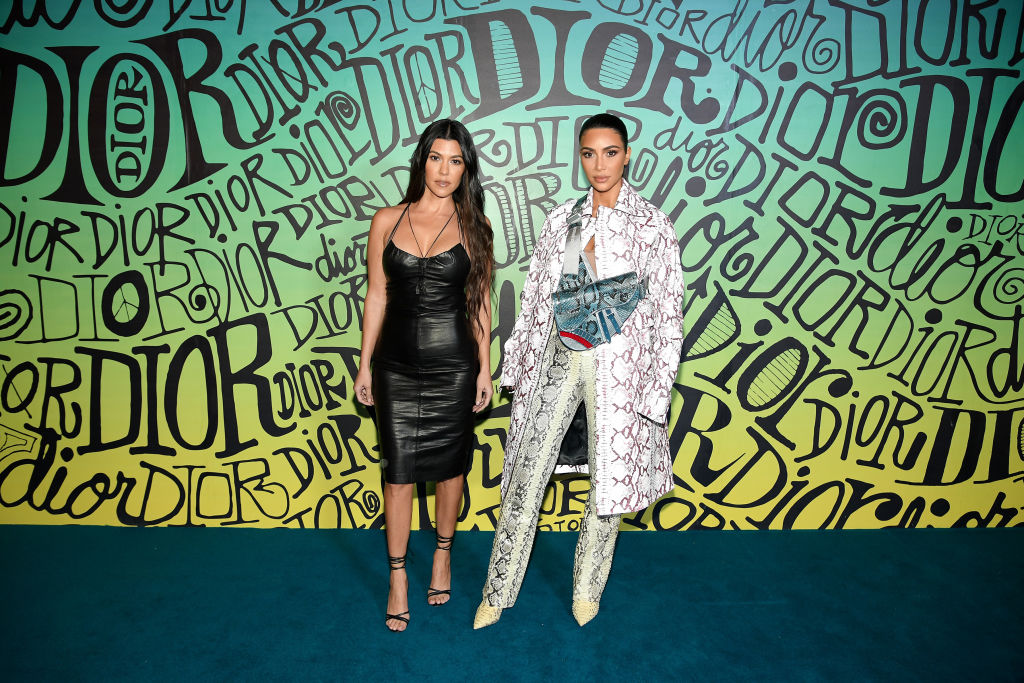 Kourtney Kardashian and Kim Kardashian West attend the Dior Men's Fall 2020 Runway Show