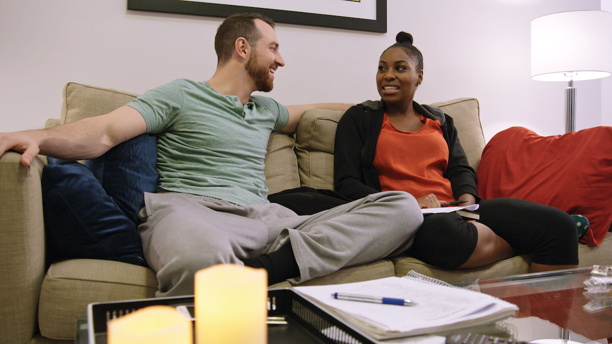 Cameron and Lauren on a couch after they moved in together on 'Love Is Blind.'