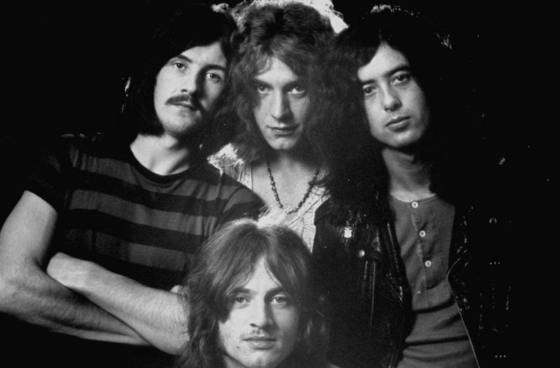 Drummer John Bonham, bassist/keyboardist John Paul Jones (seated), singer Robert Plant, and guitarist Jimmy Page of rock music group Led Zeppelin