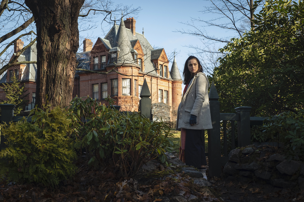 """Marta in front of Harlan Thrombey's mansion, """"helping"""" with the murder case in 'Knives Out.'"""
