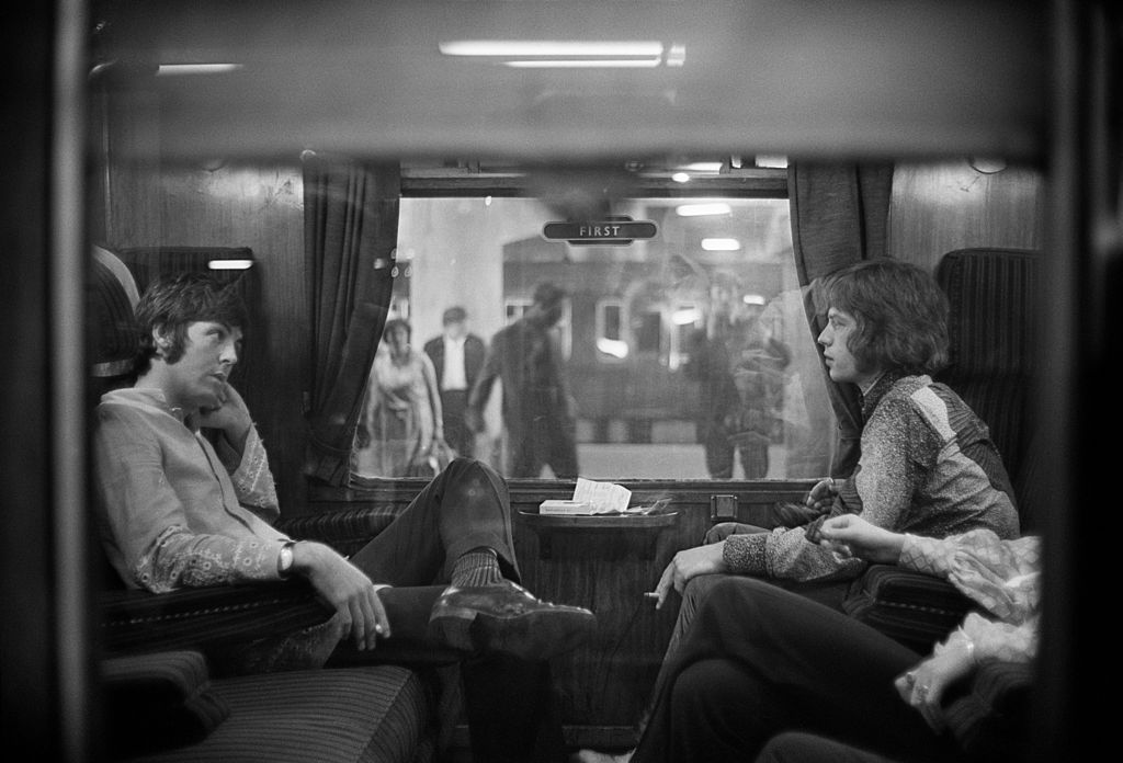 The Beatles' Paul McCartney and The Rolling Stones' Mick Jagger on a train