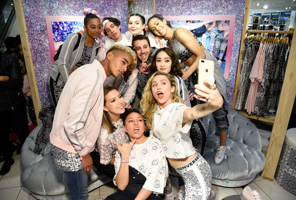 Miley Cyrus and fans post during Converse X Miley Cyrus Pop-Up Shop at The Grove on May 1, 2018 in Los Angeles, California.