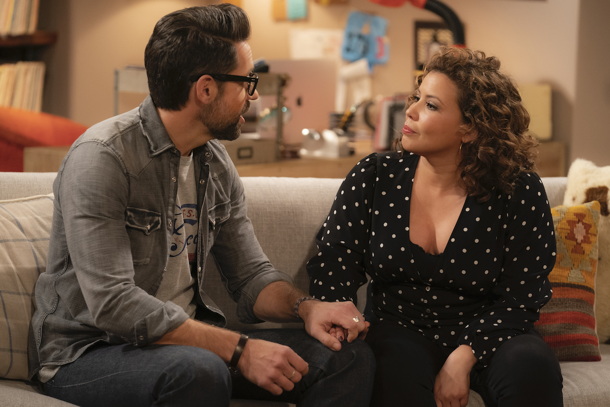Todd Grinnell as Schneider and Justina Machado as Penelope in ONE DAY AT A TIME.