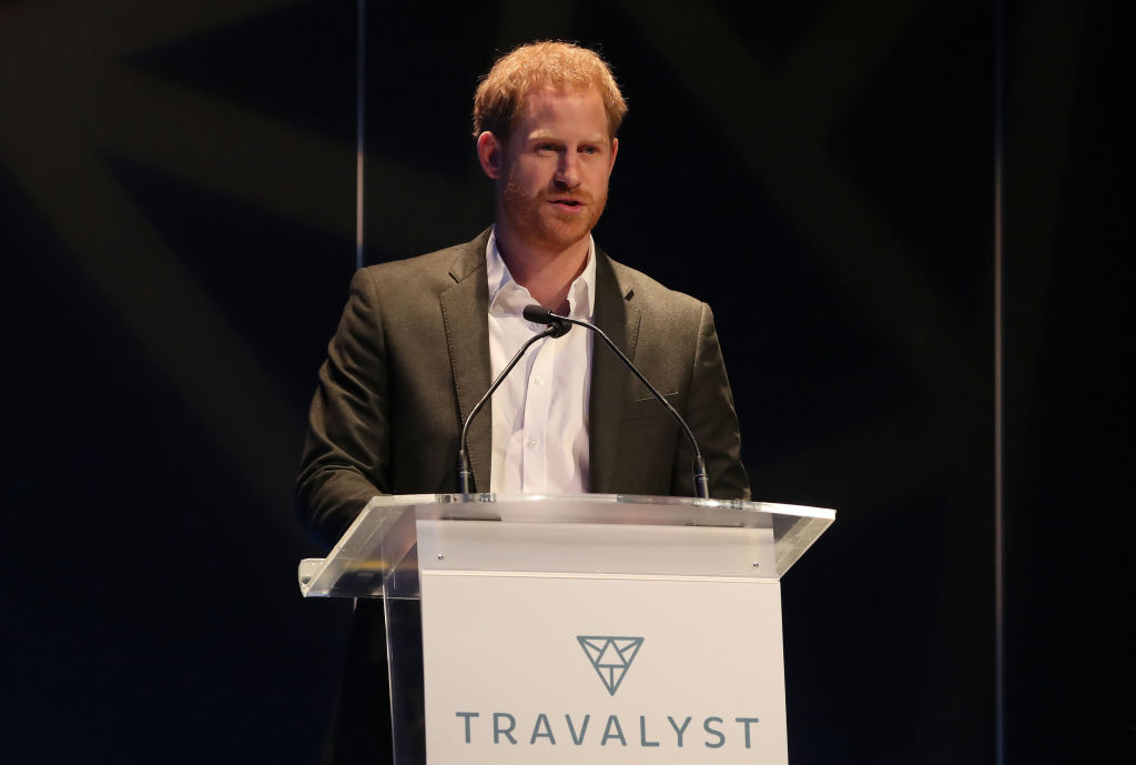 Prince Harry speaks as he attends a sustainable tourism summit at the Edinburgh International Conference Centre