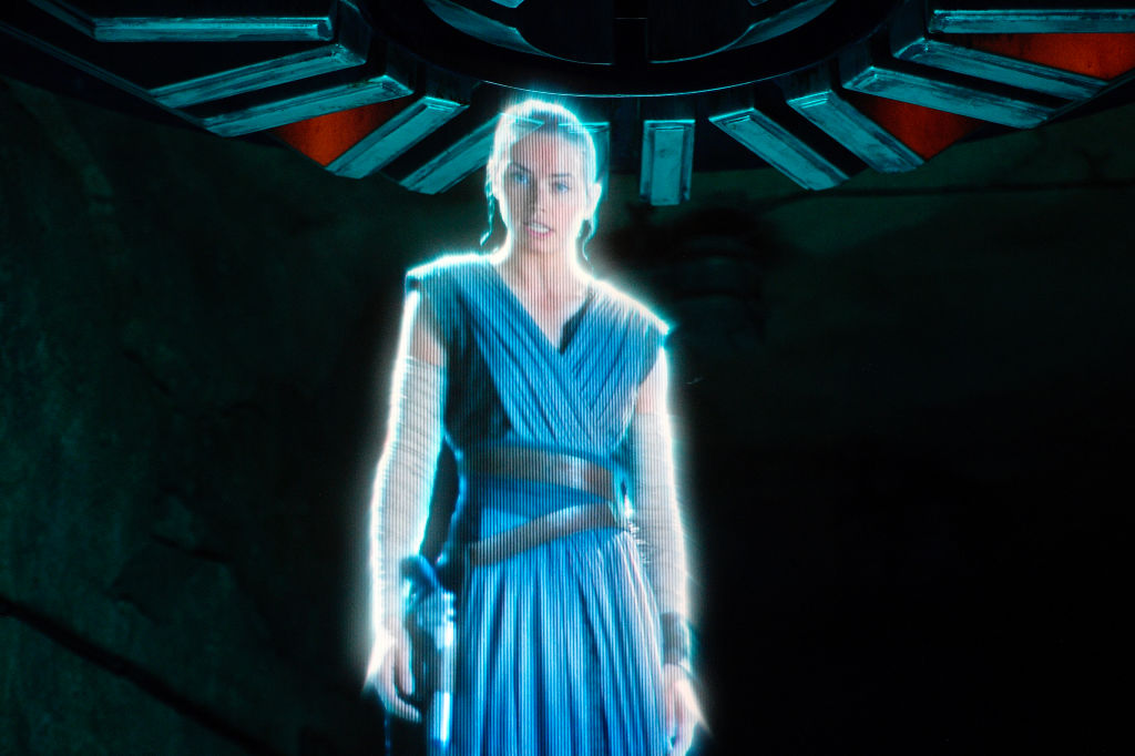 A hologram of Rey greets resistance fighters during Rise of the Resistance at Star Wars: Galaxy's Edge inside Disneyland in Anaheim, California.