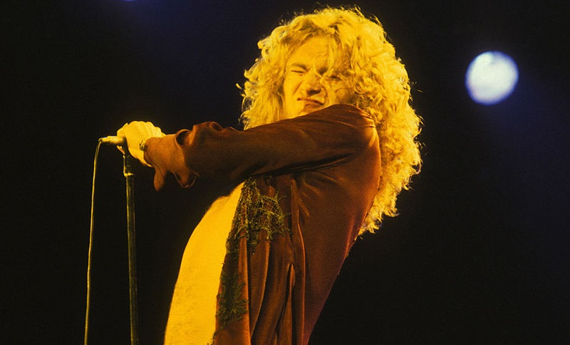 Robert Plant from Led Zeppelin holding a microphone