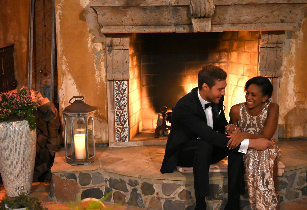 Shiann Lewis with Peter Weber on the first night of his 'The Bachelor' season in front of a fireplace.