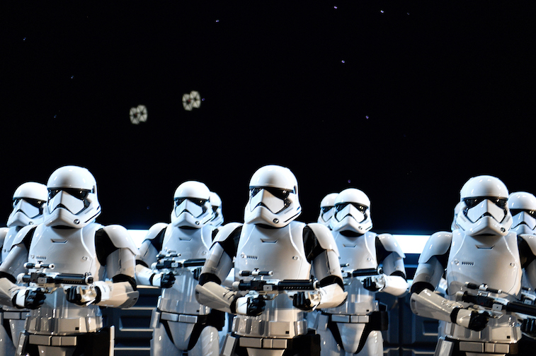 Stormtroopers stand guard on the flight deck of a Star Destroyer during Rise of the Resistance at Star Wars: Galaxy's Edge