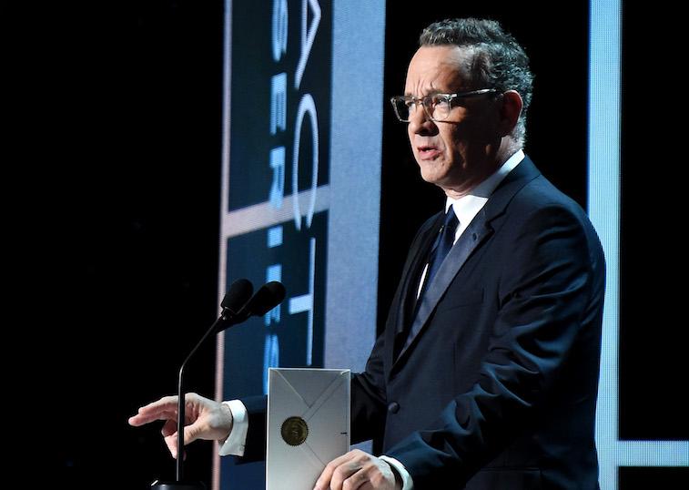 Tom Hanks speaks onstage