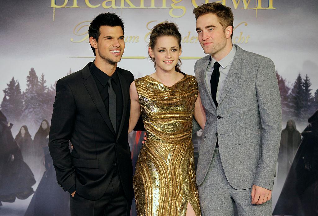 Taylor Lautner, Kristen Stewart, and Robert Pattinson at the German premiere of 'Twilight Saga: Breaking Dawn Part 2.'