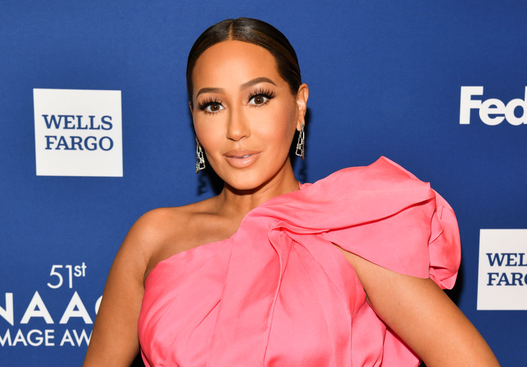 Adrienne Bailon on the red carpet at an award show in February 2020