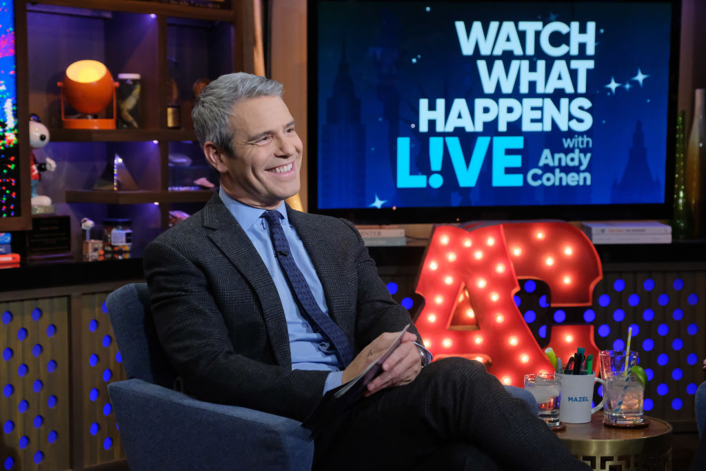 Andy Cohen smiling seated on his talk show