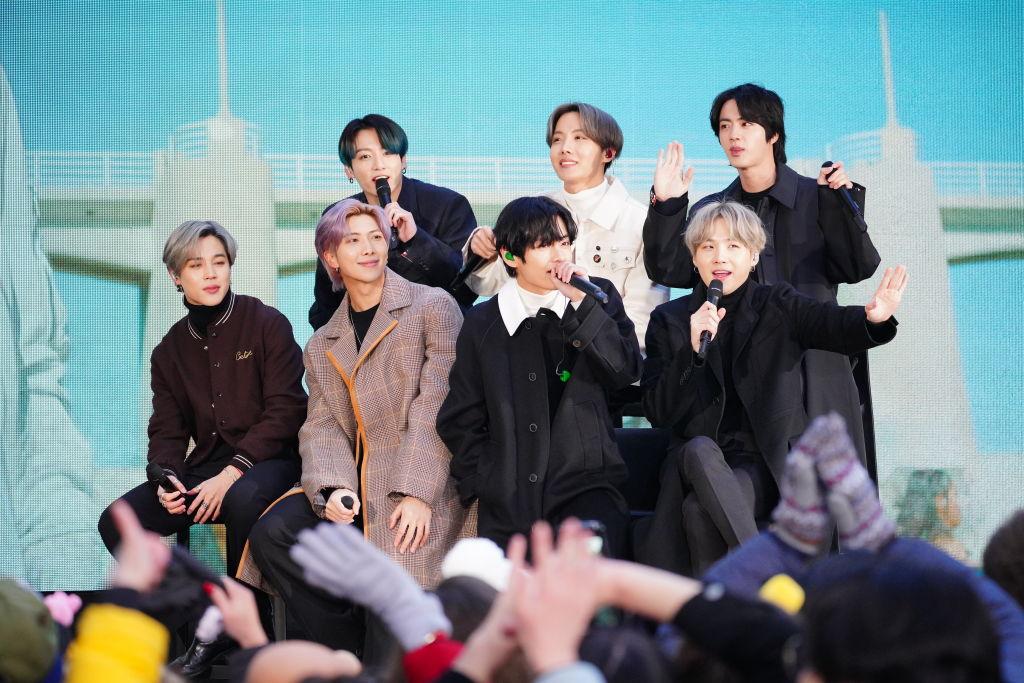 J-Hope, SUGA, Jungkook, Jimin, RM, V and Jin of BTS interviewing