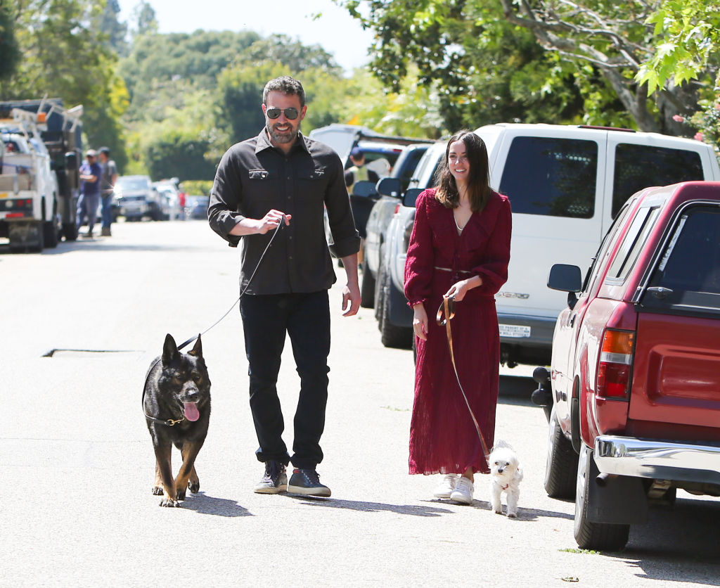 Ben Affleck and Ana de Armas walking their dogs in the stree