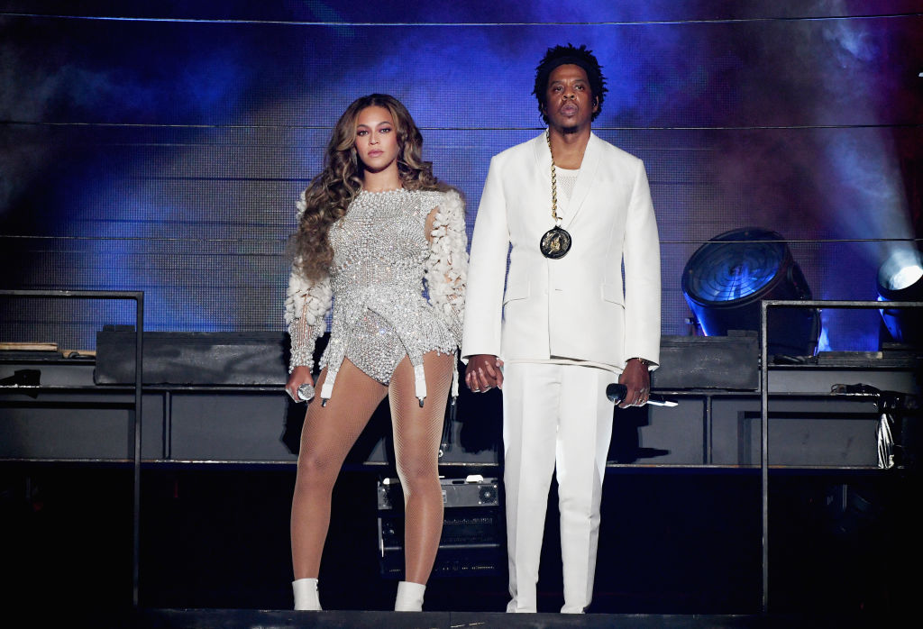 Beyoncé and Jay-Z holding hands on stage