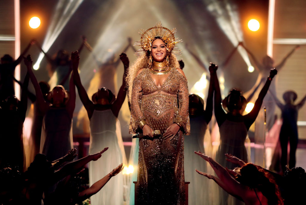Beyoncé smiling on stage with a crown