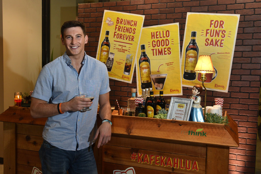 Blake Horstmann from 'The Bachelorette' holding a Cold Brew Martini at the Rethink Food's Cold Brew Cafe