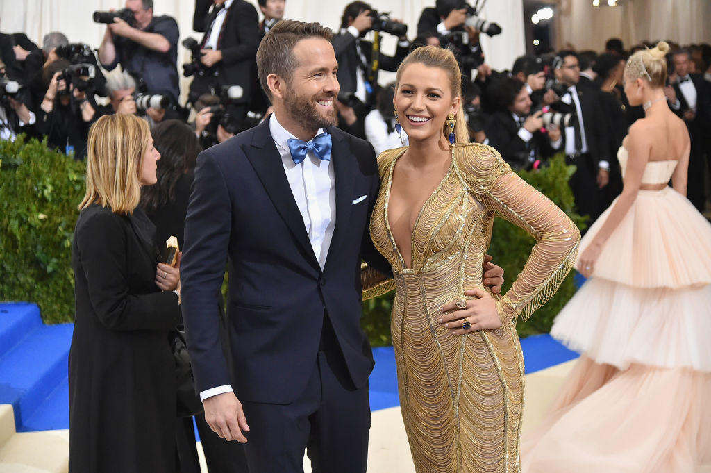 Ryan Reynolds and Blake Lively laughing on a red carpet