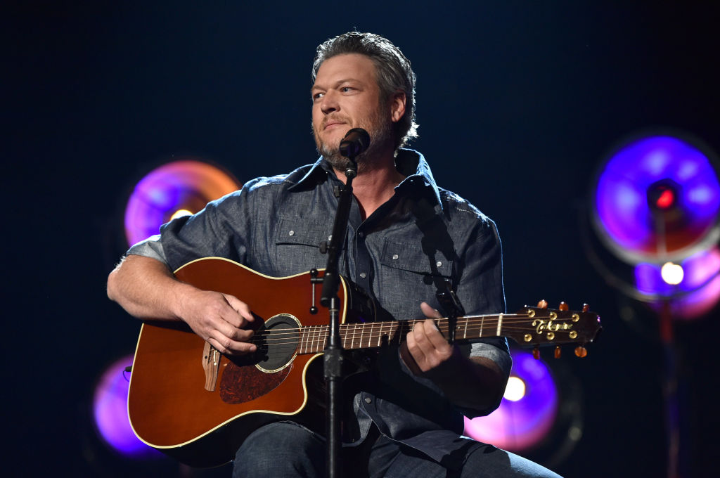 Blake Shelton on stage with a guitar