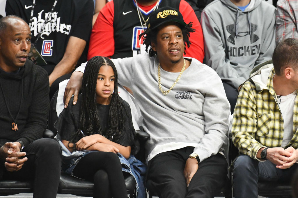 Blue Ivy Carter attend a basketball game