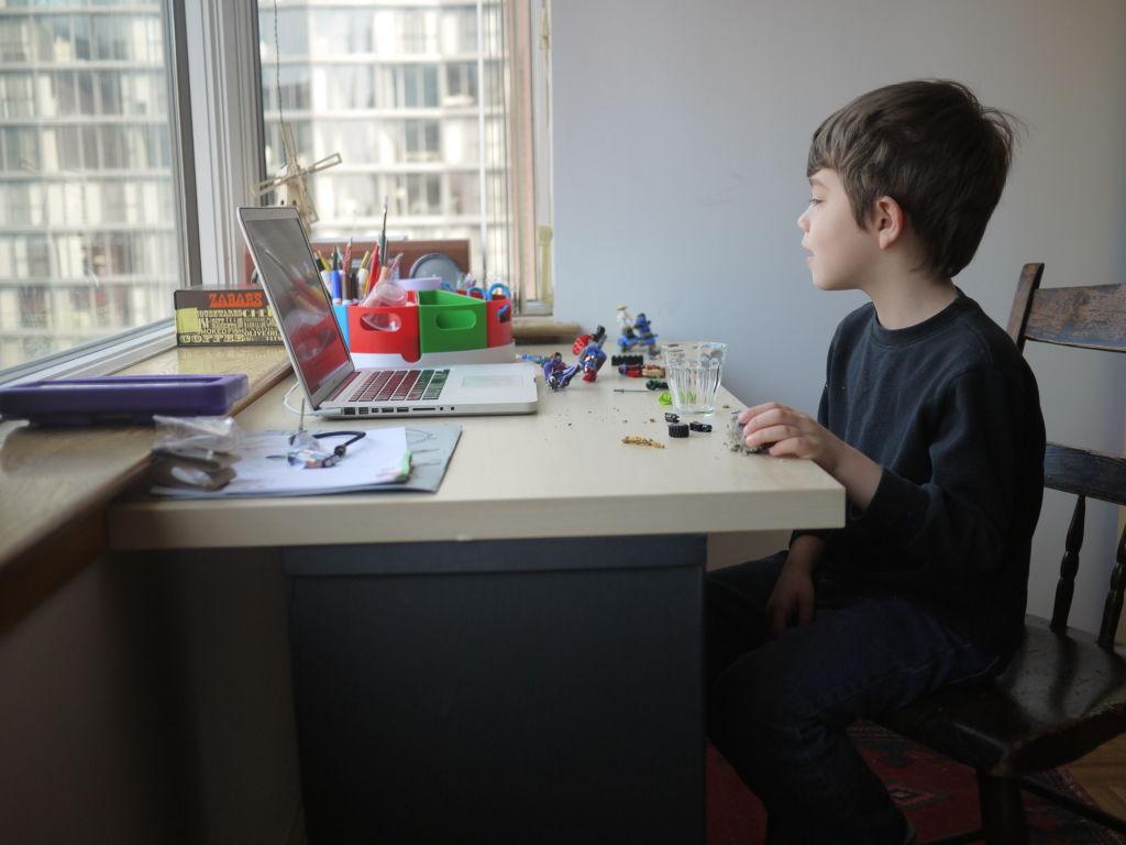 Boy taking online classes